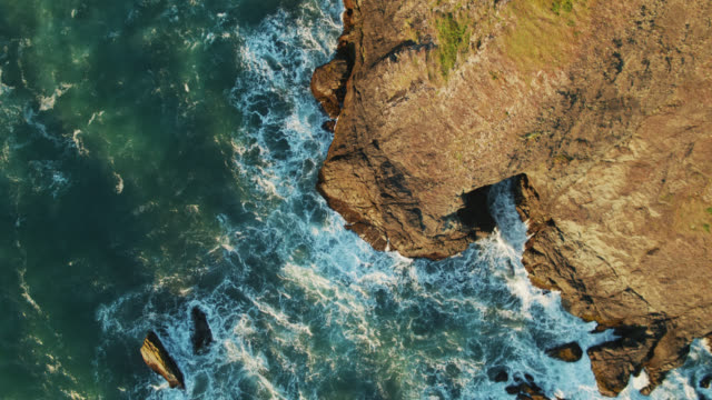 top down drone shot of waves crashing on rocks near house rock - oregon coast stock videos & royalty-free footage
