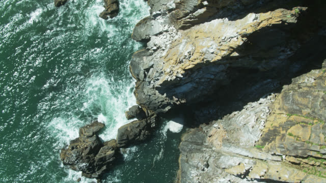 top down shot of jagged cliffs on oregon coast - oregon coast stock videos & royalty-free footage