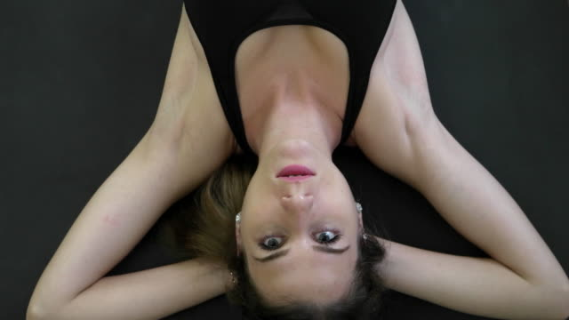 Top down shot of Woman training and working out, stretching, dumb-bells,