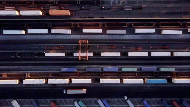 top down view of cargo container being loaded onto freight train - cargo train stock videos & royalty-free footage