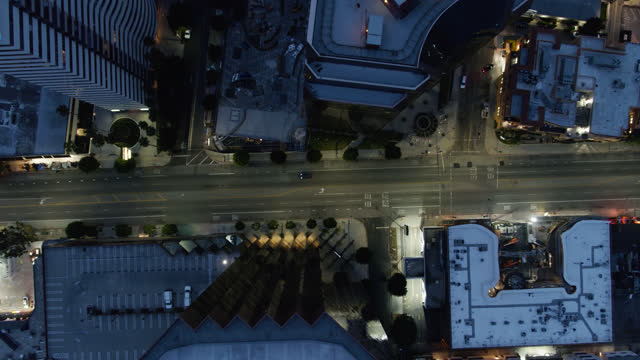 top down view of west los angeles tower rooftops at night - aerial - beverly hills stock videos & royalty-free footage