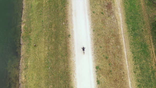 top down view on a boy cycling along a trail. - 8 9 years stock videos & royalty-free footage
