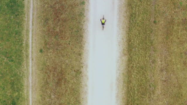 top down view on a boy cycling on a trail. - 8 9 years stock videos & royalty-free footage
