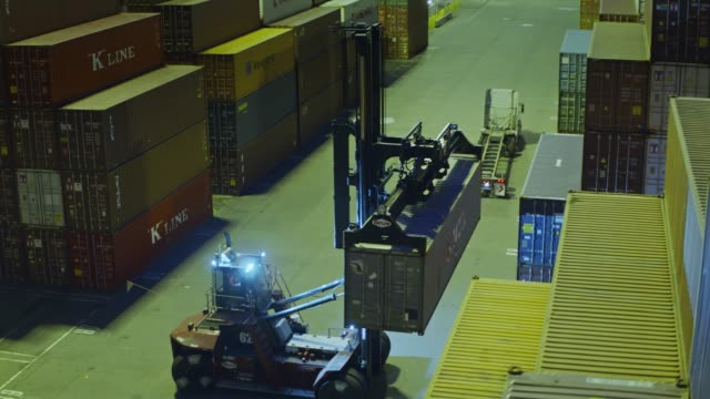 top handler arranging shipping containers - drone shot - container stock videos & royalty-free footage