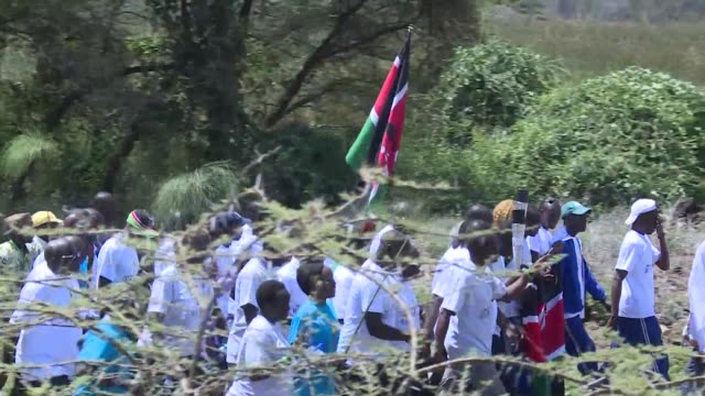 top kenyan athletes on thursday completed a giant 840 kilometre walk for peace against ethnic violence accompanied by cheering crowds - kilometre stock videos & royalty-free footage