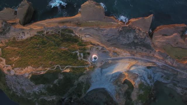 Top Looking down at Castlepoint Lighthouse.