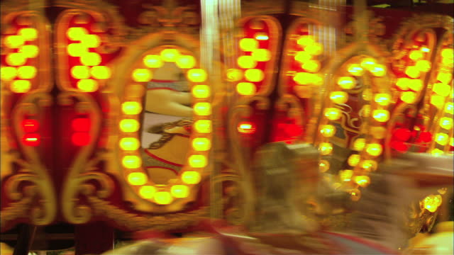 top mirrored portion of moving carousel - fairground stock videos and b-roll footage
