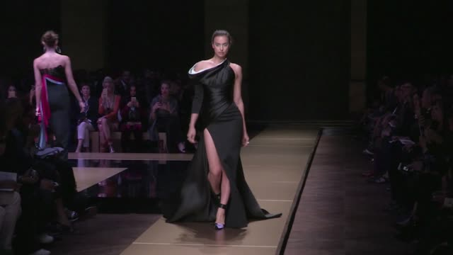 Top Model Irina Shayk walk the runway for the Atelier Versace Haute Couture Fashion show in Paris with boyfriend Bradley Cooper watching her front...