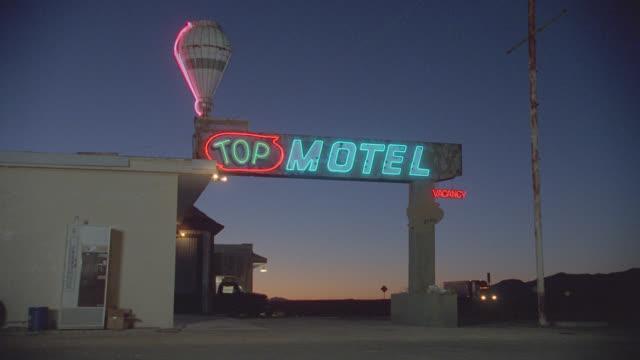 "n/x (dark sunset) ""top"" motel; traffic by in b.g.; rural setting; sev'l views - motel stock videos & royalty-free footage"