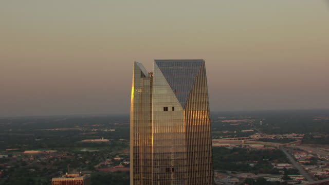 WS AERIAL Top of Devon Tower during sunset with other buildings / Oklahoma City, Oklahoma, United States