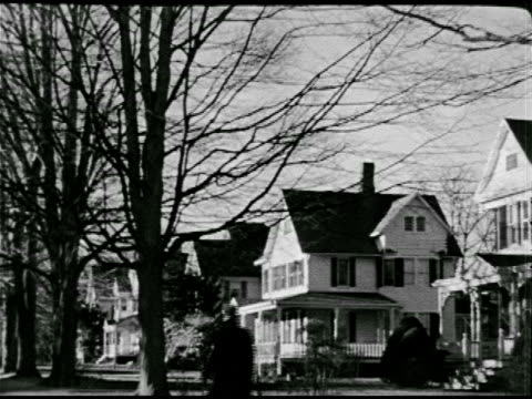 vídeos de stock e filmes b-roll de xws small town w/ tall church steeple ws middleclass neighborhood homes ws church w/ two women walking sidewalk ha ws large school w/ clock tower - 1947