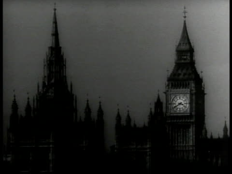 top of houses of parliament clock tower cu framed photos of king george vi queen elizabeth dated may 12th royal carriage royal coach drawn by horses... - coronation stock videos and b-roll footage