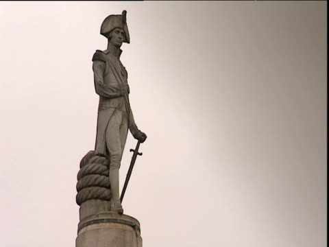 top of nelson's column dramatic clouds behind - nelson's column stock videos & royalty-free footage