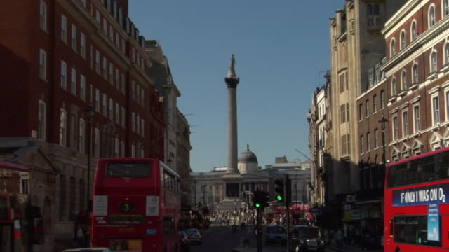 ms top of nelson's column/ zo ws traffic and pedestrians passing through trafalgar square/ london, england - nelson's column stock videos and b-roll footage
