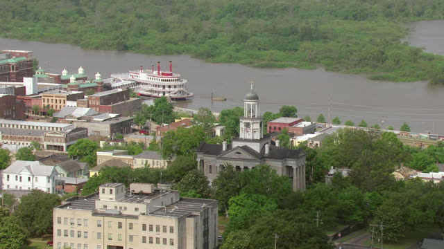 MS AERIAL Top of Old Courthouse and downtown with riverboat casino with Mississippi River / Vicksburg, Mississippi, United States