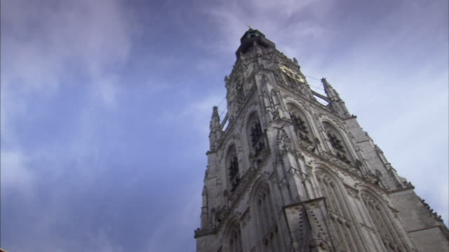 t/l, cu, la, top of tower of our lady church against sky, breda, netherlands - circa 15th century stock videos & royalty-free footage
