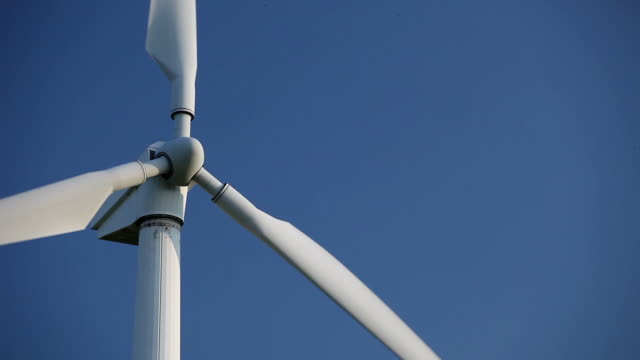 cu top of wind turbine against blue sky, mecklenburg-vorpommern, germany - 風力発電点の映像素材/bロール