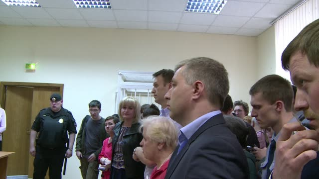 top russian opposition leader alexei navalny was found guilty on tuesday of slandering a lawmaker and ordered to pay a hefty fine the latest legal... - critic stock videos & royalty-free footage