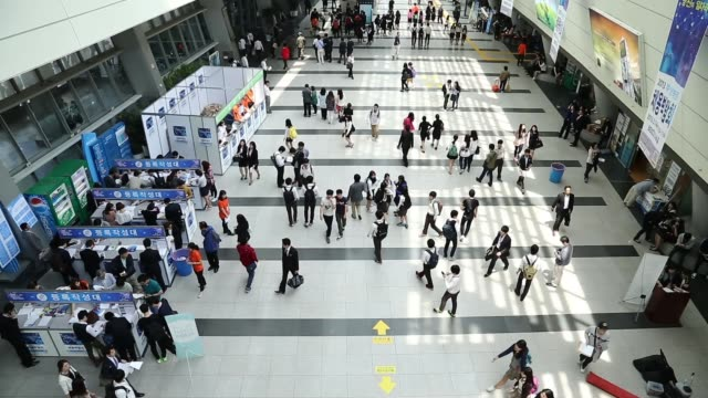 top shot job seekers fill out application forms during a job fair at the busan exhibition and convention center in busan high angle view job seekers... - unemployment application stock videos & royalty-free footage