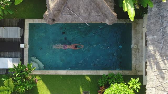 top shot of a man in swimming pool