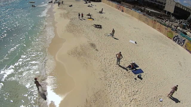 MS AERIAL Top Shot of People enjoying in Playa Del Carmen beach / Playa DelCarmen, United States