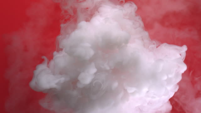 top shot of smoke movement coming from dry ice in water - red cloud sky stock videos & royalty-free footage