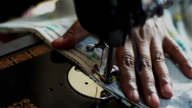 Top shot of stitching using sewing machine.