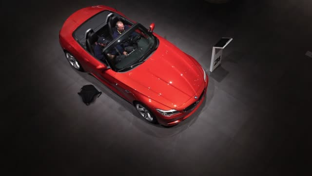 top shots visitors look at a bmw z4 automobile produced by bayerische motoren werke ag at the 65th frankfurt international motor show in frankfurt... - handelsmesse stock-videos und b-roll-filmmaterial