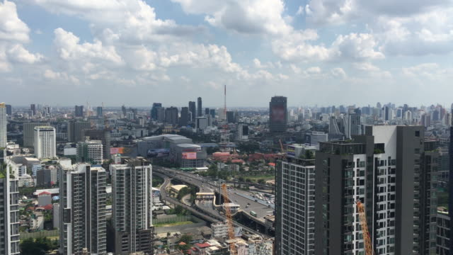 stockvideo's en b-roll-footage met bovenaanzicht gebouw van de stad in rama 9 business district bangkok, thailand - infaden