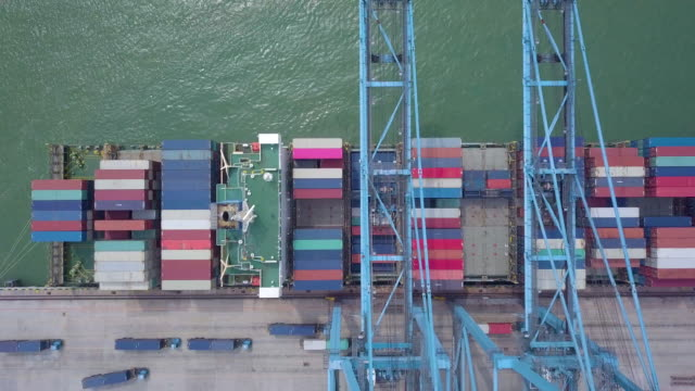 top view container harbor with crane - malaysia stock-videos und b-roll-filmmaterial