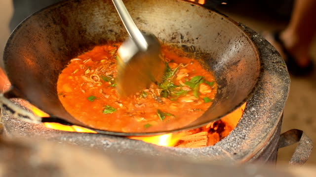 top view: cooking spice food in a hot pan - camping stove stock videos and b-roll footage