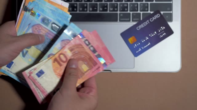Top view Euro currency and credit card money for online purchases.