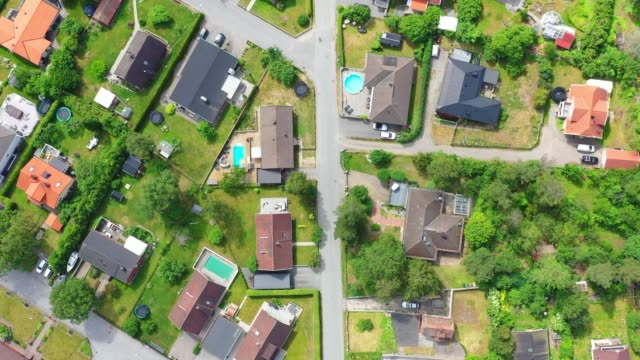 top view, flying over idyllic villa area - inquadratura da un aereo video stock e b–roll