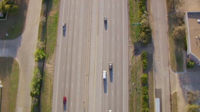 ms aerial top view high over i30 with cars driving / dallas, texas, united states - autostrada interstatale americana video stock e b–roll
