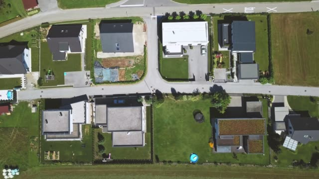 top view of a small new countryside neighborhood with farming fields around - residential district stock videos & royalty-free footage