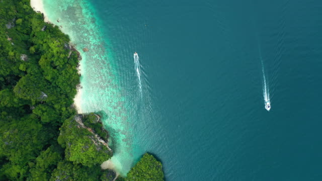 top view of boat sailing near a coastline - phi phi le stock videos & royalty-free footage