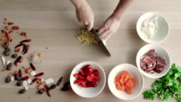 Top View of Chefs Hands Chopping Ginger On Wooden Board, Healthy Food Concept