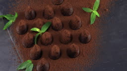 Top view of chocolate truffles sprinkled with cocoa
