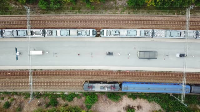 top view of commuter train - rail transportation stock videos & royalty-free footage