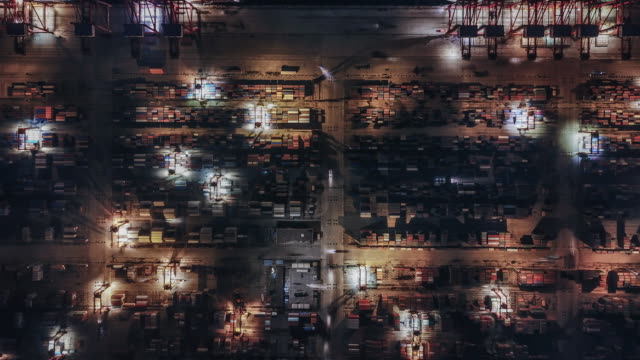 t/l top view of container terminal at night - large stock videos & royalty-free footage