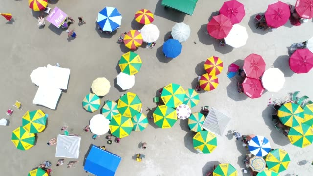 top view of crowd beach - parasol stock videos & royalty-free footage