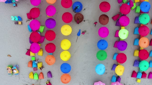 top view of crowded beach with colorful umbrellas - parasol stock videos & royalty-free footage