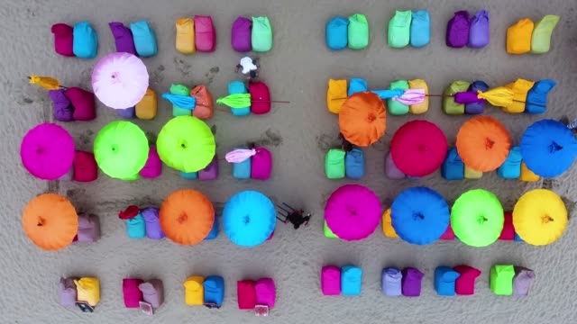 top view of crowded beach with colorful umbrellas - beach umbrella stock videos and b-roll footage