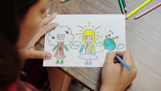 top view of designer drawing on paper - colouring stock videos & royalty-free footage