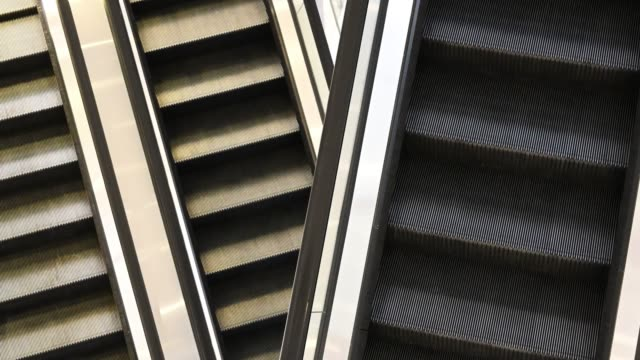 top view of escalators moving staircase running up and down - escalator stock videos & royalty-free footage