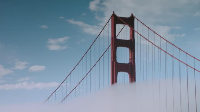 stockvideo's en b-roll-footage met ms top view of foggy golden gate bridge tower - baai van san francisco