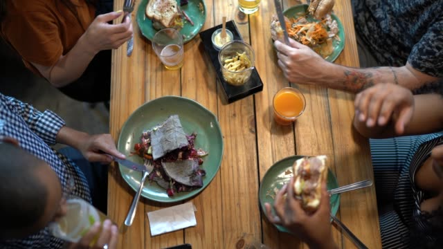 top view of friends having a lunch together - lunch stock videos & royalty-free footage