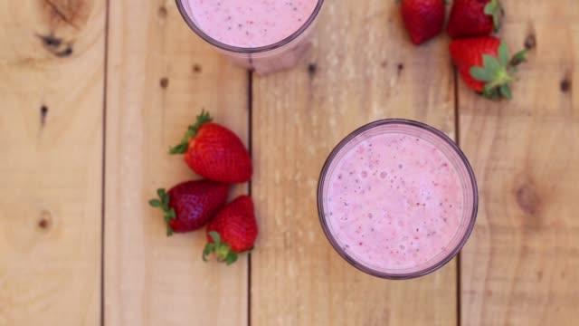 top view of healthy strawberry milkshakes with chia seeds - strawberry milkshake stock videos & royalty-free footage
