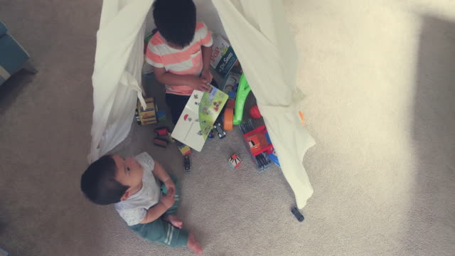Top View Of Kids Playing Under Tent.