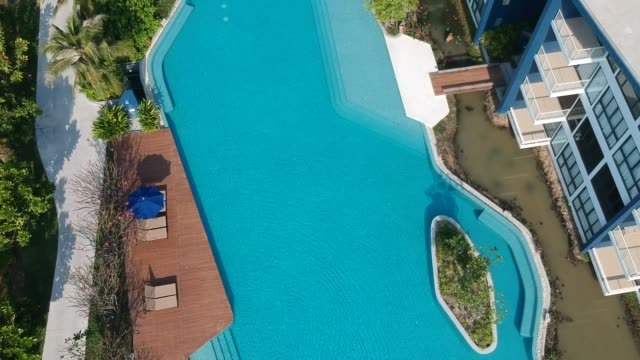 top view of luxury swimming pool - infinity pool stock videos & royalty-free footage